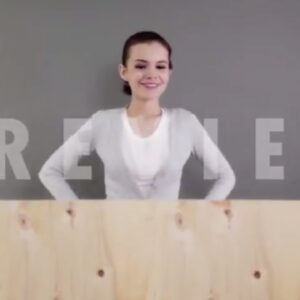 DropMock Demo Video of a girl who placed the wood board in front of her to view the placement ad